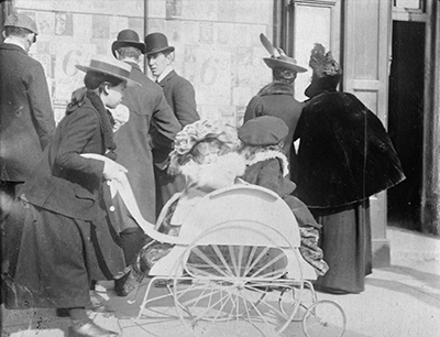 Young girl pushing 2 infants in a perambulator 1904